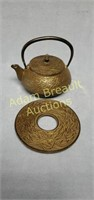 Made in Japan 5 inch cast iron teapot and trivet