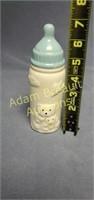 Vintage 7in porcelain baby bottle coin Bank