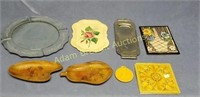8 assorted decorative trays and trivets