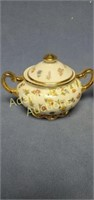 Vintage porcelain sugar creamer set and plant