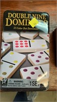 Tin of dominoes