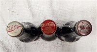 (3) international Coca-Cola bottles