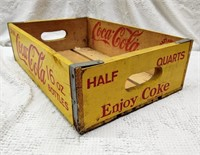 yellow wooden Coca-Cola