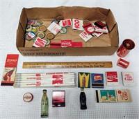 box of Coca-Cola advertising items