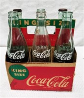 (6) king-size Coca-Cola bottles in container