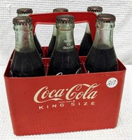 (6) Coca-Cola in red plastic carrier