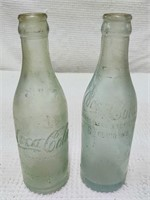 (2) early Coca-Cola bottles