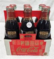 six pack 100 Year Olympic Anniversary Coke bottles