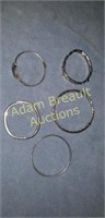 5 silver bracelets