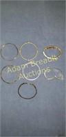 7 gold bracelets
