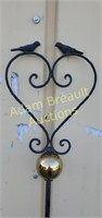 Wrought iron decorative bird and Globe garden