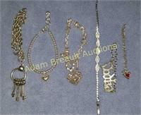 6 silver charm bracelets