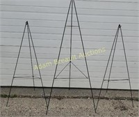 3 green metal collapsible wreath stands