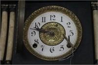 Antique black mantle clock w/ pillar design