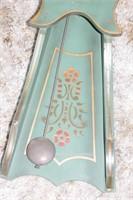 green wooden pendulum clock w/ key