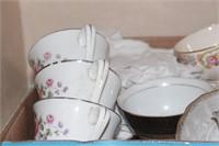 Large assortment of tea cups & saucers