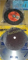 Assorted circular saw blades and grinding discs