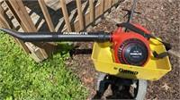 Fertilizer spreader with leaf blower