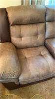 Disstressed brown leather rocking reclining sofa.
