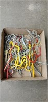 Box of assorted wall and pegboard hangers