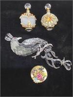 2 jeweled perfume bottles, enameled powder box,