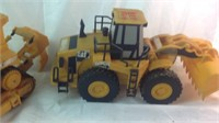 Two plastic caterpillar toy vehicles