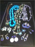 Assorted costume jewelry including necklaces and