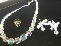 Clear beaded necklace and earrings matched with a