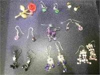 Assortment of 8 pairs of.fashion costume jewelry