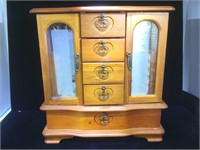 11'' wide, 12'' high brown jewelry cabinet with 4