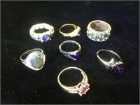 Assortment of 7 costume jewelry rings.