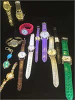Assortment of 13 costume jewelry watches . Face