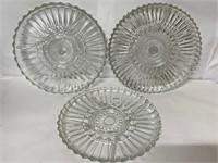 Three like segregated glass platters