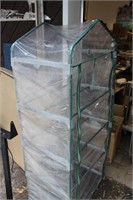 SMALL ENCLOSED GREENHOUSE