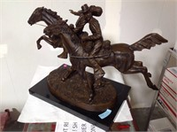 Frederick Remington, bronze , with a marble base,