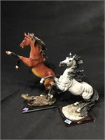 2 Statues of Raised stallions, resin , 21 in H,