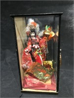 Lg cased Oriental doll, 21 inches H