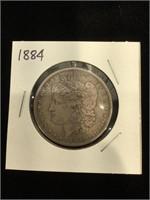 1884 Morgan Silver Dollar in flip