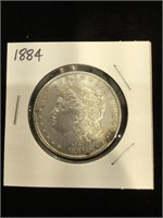 1884 Morgan Silver Dollar in flip