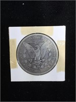 1899-O Morgan Silver Dollar in flip