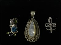 Pair of Sterling Silver pendants and Sterling