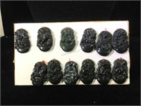 Lot of 12 carved dark green stone Zodiac pendants