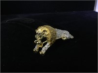 Heavy metal Lion brooch with clear and green