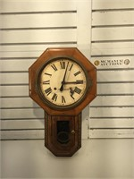 Antique wall clock with key. It is missing the