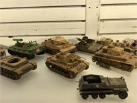 Group of toy model WW2 tanks and other vehicles