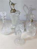 5 crystal and pressed glass decanters , cut glass