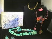 3 Necklaces, 1 earrings  in a jewelry box
