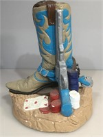 Ceramic western boot , pistol and poker chips