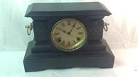 Vintage cast metal mantle clock