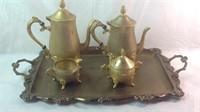Gold colored tea serving set